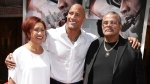 Dwayne 'The Rock' Johnson says he is 'full of gratitude' for the love and support he's received in the wake of his father's death. Eric Charbonneau/Invision for Warner Bros/AP Images