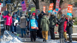 Striking teachers from Kew Beach Junior Public School in Toronto cheer as passing cars honk their horns in support on Monday, January 20, 2020. THE CANADIAN PRESS/Frank Gunn