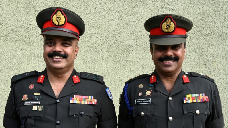 Twin Sri Lankan army generals Jayantha and Pooraka Seneviratne were among the thousands who turned up for the record attempt. (AFP)