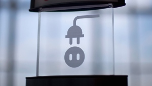 A sign for an electrical outlet stands in the Maynard Holbrook Jackson Jr. International Terminal at Atlanta's airport Wednesday, March 28, 2012. (AP Photo/David Goldman)