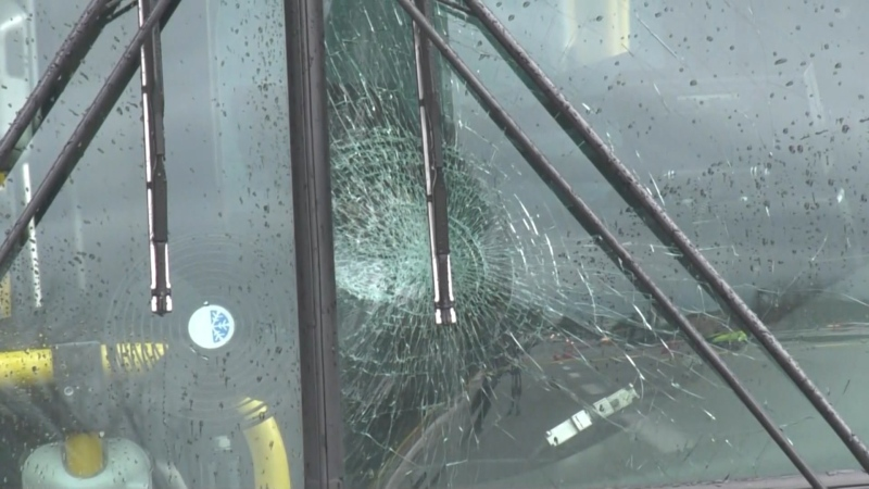 The damaged windshield of a transit bus is seen on Jan. 20, 2020.