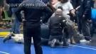 Man arrested after attacking high school wrestler