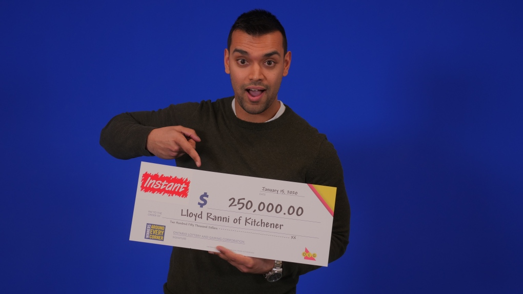 Lloyd Ranni with an OLG cheque