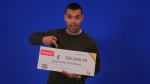 Lloyd Ranni poses with his OLG cheque. (Source: OLG)