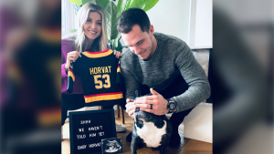Bo Horvat, his wifem Holly, and their dog are shown in an image posted on Instagram.