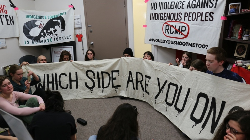 Members of Climate Justice Toronto are seen at an occupation of Deputy Prime Minister Chrystia Freeland's constituency office in Toronto. (Climate Justice Toronto/Supplied)