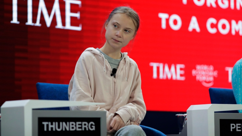 Swedish environmental activist Greta Thunberg takes her seat prior to the opening session of the World Economic Forum in Davos, Switzerland, Tuesday, Jan. 21, 2020. (AP Photo/Markus Schreiber)