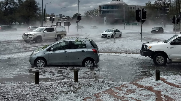 Hail covers vehicles in an intersection Monday, Jan. 20, 2020, in Canberra, Australia. (Tom Swann/The Australia Institute via AP)