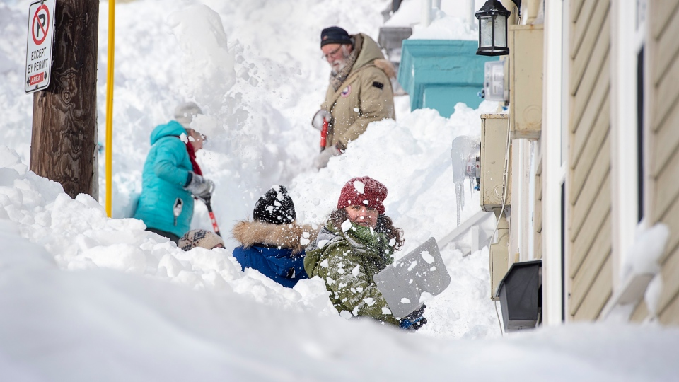 Residents shovel their sidewalk in St. John's on Sunday, Jan. 19, 2020. THE CANADIAN PRESS/Andrew Vaughan