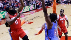 Houston Rockets guard James Harden (13) shoots as Oklahoma City Thunder guard Luguentz Dort defends during the first half of an NBA basketball game, Monday, Jan. 20, 2020, in Houston. (AP Photo/Eric Christian Smith)
