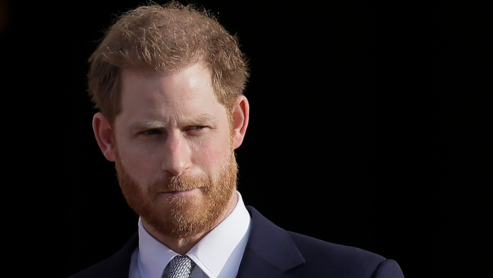In this Thursday, Jan. 16, 2020, file photo, Britain's Prince Harry arrives in the gardens of Buckingham Palace in London. (AP Photo/Kirsty Wigglesworth, File)
