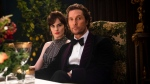 """This image released by STXfilms shows Michelle Dockery, left, and Matthew McConaughey in a scene from """"The Gentlemen."""" (Christopher Raphael/STXfilms via AP)"""