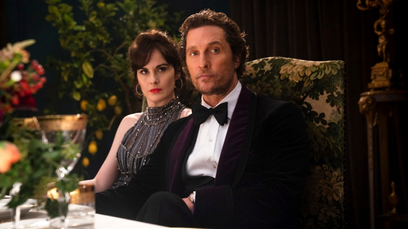 "This image released by STXfilms shows Michelle Dockery, left, and Matthew McConaughey in a scene from ""The Gentlemen."" (Christopher Raphael/STXfilms via AP)"