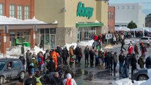 Customers line up at a Sobeys grocery store in St. John's on Tuesday, January 21, 2020. (THE CANADIAN PRESS/Andrew Vaughan)