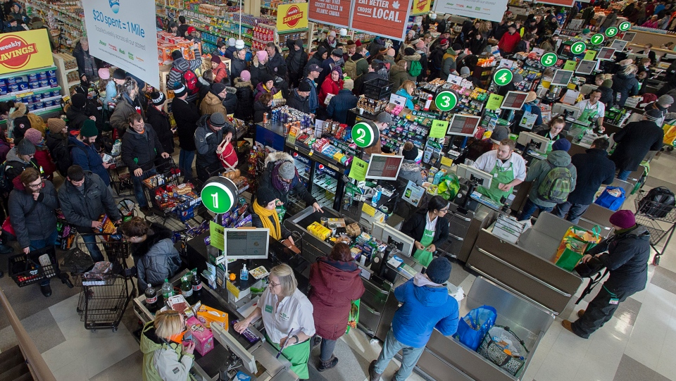 Customers pack a Sobeys grocery store in St. John's on Tuesday, January 21, 2020. The city allowed grocery and convenience stores to open for limited hours to let residents restock their food supply following a massive blizzard. (THE CANADIAN PRESS/Andrew Vaughan)