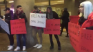 Questions are swirling around the motivations of a group of young protesters who showed up at the Huawei CFO's extradition hearing, carrying hastily-made signs and refusing to answer questions. (Bob Mackin/theBreaker.news)