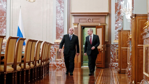 Russian President Vladimir Putin, right, and new Russian Prime Minister Mikhail Mishustin arrive to attend a new cabinet meeting in Moscow, Russia, on Jan. 21, 2020. (Dmitry Astakhov, Sputnik, Government Pool Photo via AP)