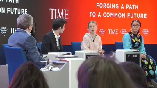 Autumn Peltier sits next to Greta Thunberg