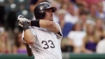 Colorado Rockies' Larry Walker, of Maple Ridge, B.C. watches the flight of his two-run home run on a pitch from San Diego Padres starting pitcher Kevin Jarvis in the third inning in Denver's Coors Field on Monday, June 25, 2001. THE CANADIAN PRESS/AP, David Zalubowski