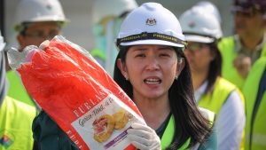 Malaysia's Minister of Energy, Science, Technology, Environment and Climate Change Yeo Bee Yin shows a sample of a plastic waste shipment in Port Klang, Malaysia, Tuesday, May 28, 2019. THE CANADIAN PRESS/AP/Vincent Thian