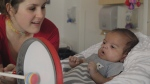 Musical therapist Tanya Lavoie with premature baby Logan. Still image from the documentary Tuning the Brain with Music.