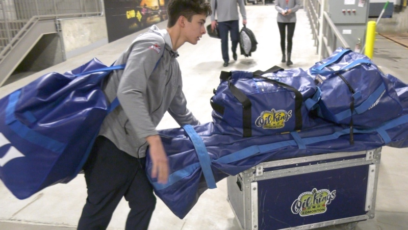 Edmonton Oil Kings player, loading equipment onto bus. January 21, 2020 (CTV News Edmonton)