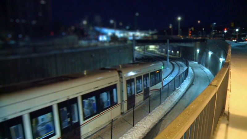 A train approaches a station along the Confederation Line of Ottawa's Light Rail System.