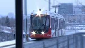 A westbound train travels along the Confederation Line of Ottawa's Light Rail System.