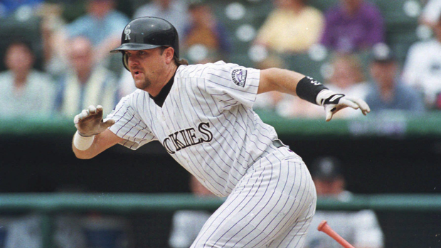 Colorado Rockies' Larry Walker breaks from the batter's box after laying down a bunt single on a pitch from Cincinnati Reds' Mike Remlinger in the fifth inning of the Rockies' 6-4 victory in game one of a day-night doubleheader in Denver's Coors Field on July 23, 1998. (AP, David Zalubowski)