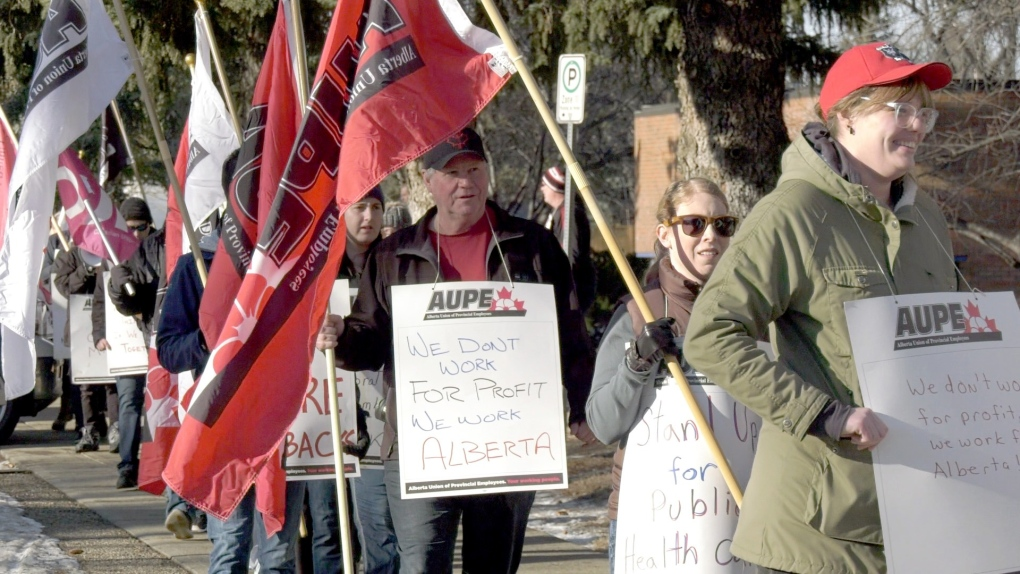 Frontline workers, union members, and supporters rally against healthcare cuts in Lethbridge