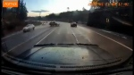Dashcam video shot by Chris Secord shows a mid-size SUV pass him on the right near Humpback Road Tuesday morning before spinning out of control into oncoming traffic. (Chris Secord)