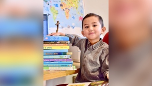Muhammad Haryz Nadzim was invited to join Mensa after meeting with a psychologist and scoring 142 on the Stanford-Binet IQ test, placing him in the 99.7th percentile, his mother, Nur Anira Asyikin, told CNN. (Courtesy: Nur Anira Asyikin)