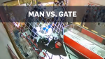 Caught on cam: Burglar trapped by security gate