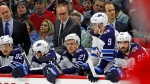 Winnipeg Jets head coach Paul Maurice, center, watches from the bench during the third period of an NHL hockey game against the Carolina Hurricanes in Raleigh, N.C., Tuesday, Jan. 21, 2020. (AP Photo/Karl B DeBlaker)