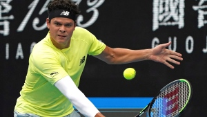 Canada's Milos Raonic makes a backhand return to Chile's Cristian Garin during their second round singles match at the Australian Open tennis championship in Melbourne, Australia, Wednesday, Jan. 22, 2020. (AP Photo/Lee Jin-man)
