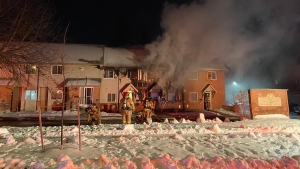 London fire crews battle a fire at a row of townhouses on Kimberley Avenue on Jan. 21, 2020. (Courtesy London Fire Department)