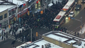 Commuters wait to board shuttle buses on Jan. 22, 2020. (CTV News Toronto's chopper)