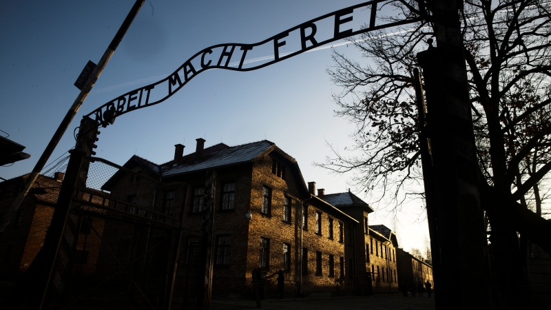 In this Dec. 6, 2019, file photo, the sun lights the buildings behind the entrance of the former Nazi death camp of Auschwitz-Birkenau in Oswiecim, Poland. (Photo/Markus Schreiber, File)