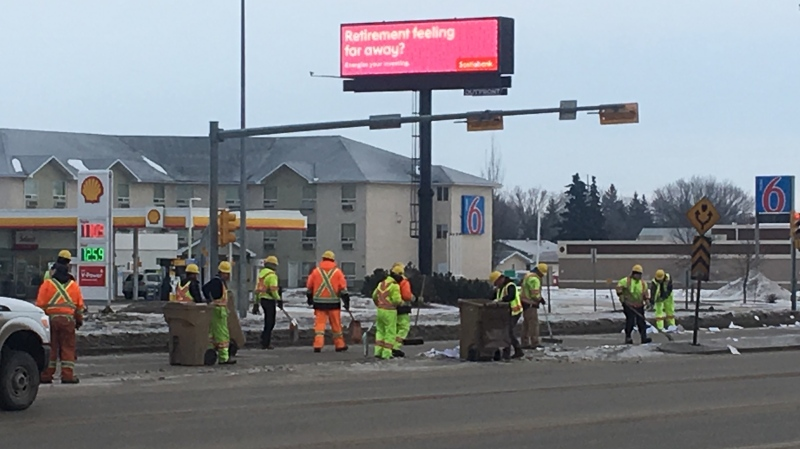 Crews clean up papers on Victoria Avenue on Jan. 22, 2020 (Katy Syrota / CTV News Regina)
