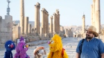 "This image released by Sesame Workshop shows, from left, Grover, Basma, Ma'zooza and Jad with Rami Delshad, who portrays Hadi in ""Welcome Sesame,"" a new, locally produced Arabic TV program for the hundreds of thousands of children dealing with displacement in Syria, Iraq, Jordan and Lebanon. (Sesame Workshop via AP)"