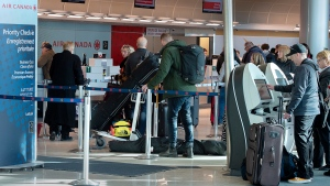Passengers prepare for their flights at the airport in St. John's on Wednesday, January 22, 2020. Air travel has resumed after being shut down for several days. (HE CANADIAN PRESS/Andrew Vaughan)