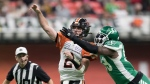 B.C. Lions quarterback Danny O'Brien (2) passes the ball as he's hit by Saskatchewan Roughriders' A.C. Leonard during the first half of a CFL football game in Vancouver, on Friday October 18, 2019. THE CANADIAN PRESS/Darryl Dyck