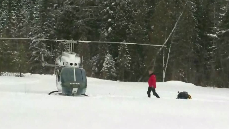 1 dead, 5 missing after snowmobilers plunge into