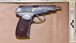 Police recovered a handgun from a vehicle after stopping to investigate a report of suspected impaired driving.