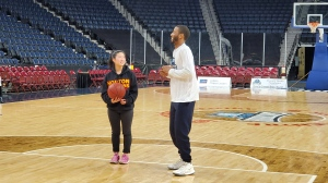 Charlotte Peng of Wolfville, N.S., who is involved in many volunteer efforts in her school and her community, is seen here shooting some hoops with Halifax Hurricanes player Tyler Scott.