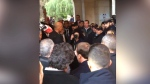 Macron confronts Israeli security in church