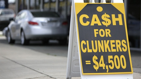 Cash for Clunkers signs are shown outside Superior Pontiac Buick GMC Friday, July 31, 2009 in Dearborn, Mich. (AP / Paul Sancya)