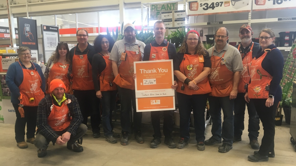 Home Depot employees helping the homeless