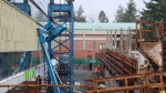 A Genie boom lift is seen tipped against a building in Abbotsford on Jan. 22, 2020. (Shane MacKichan)