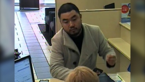 Nanaimo RCMP released a surveillance photo of the suspect, which they say shows him completing the line of credit application inside the branch. (Nanaimo RCMP)